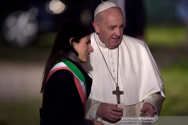 Rome mayor Virginia Raggi (L) greets Pope Francis (C) the Pope's arrival to preside the Via Crucis (Way of the Cross) torchlight procession at the ancient Colosseum (Colosseo, Colisee) on Good Friday, on April 19, 2019 in Rome.