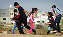 SARAB AL-AHMAD, 28 AND HASAN SHARIF, 41, AND THEIR CHILDREN FROM DAMASCUS, SYRIA PLAYING AT  THEIR NEW HOME IN MADABA, JORDAN. 20/04016. PHOTO CLARE KENDALL.