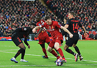 11th March 2020; Anfield, Liverpool, Merseyside, England; UEFA Champions League, Liverpool versus Atletico Madrid;  James Milner of Liverpool takes on Thomas Partey and Marcos Llorente of Atletico Madrid