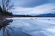 Pondicherry Wildlife Refuge - Scenic view of Presidential Range at sunset from Cherry Pond in Jefferson, New Hampshire USA during the winter months