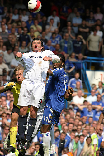 28.04.2007: London England. Bolton midfielder Gary Speed jumps to win the ball during the Premiership game between Chelsea and Bolton Wanderers, played at Stamford Bridge. The match finished 2-2.