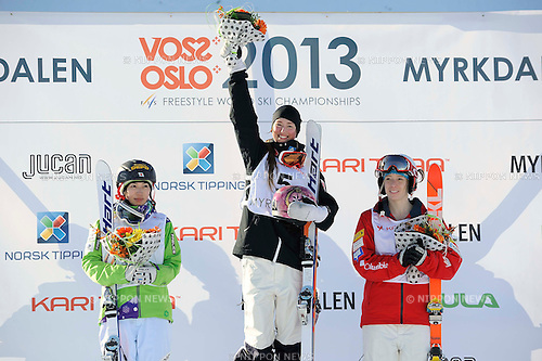 (L-R) Miki Ito (JPN), Chloe Dufour-Lapointe (CAN), Hannah Kearney (USA),.MARCH 8, 2013 - Moguls :.Chloe Dufour-Lapointe of Canada celebrates on the podium with second placed Miki Ito of Japan and third placed Hannah Kearney of the United States at the flower ceremony after winning the women's dual moguls final during the FIS Freestyle World Ski Championships in Voss-Myrkdalen, Norway. (Photo by Hiroyuki Sato/AFLO)