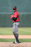 Arizona Diamondbacks relief pitcher Emilio Vargas (18) prepares to deliver a pitch to the plate during an Instructional League game against the Kansas City Royals at Chase Field on October 14, 2017 in Phoenix, Arizona. (Zachary Lucy/Four Seam Images)