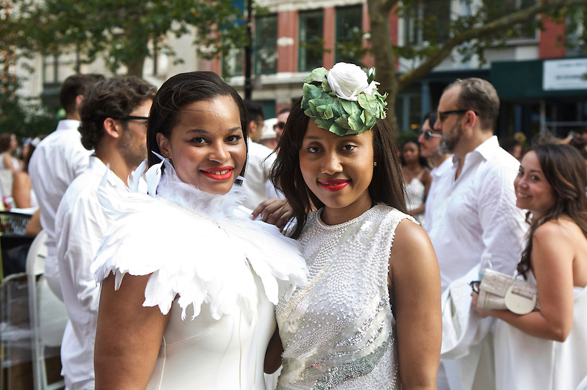 New York, NY - July 28, 2015: Diner en Blanc attendees gathered in TriBeCa ahead of the annual pop-up dinner party. CREDIT: Clay Williams for Diner en Blanc<br /> <br /> &copy; Clay Williams / claywilliamsphoto.com