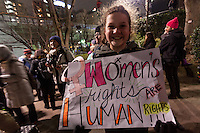 "A young woman holds a sign saying ""Women's Rights Are Human Rights"" at protest march by members of the Democratic Party Abroad organisation to mark the inauguration of President Donald Trump, Tokyo, Japan. Friday January 20th 2017 Around 400 people took apart in the march, which started in Hibiya Park at 6:30pm and finished in Roppongi just before 8pm, to honour the service given by President Obama and to protest against the illiberal policies expected of the new administration of President  Trump."
