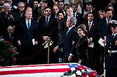 WASHINGTON, DC - DECEMBER 3 : Former president George W. Bush and wife Laura Bush look back at former president George H.W. Bush as he lies in State at the U.S. Capitol Rotunda on Capitol Hill on Monday, Dec. 03, 2018 in Washington, DC. (Photo by Jabin Botsford/Pool)