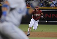 Jun 26, 2007; Phoenix, AZ, USA; Arizona Diamondbacks shortstop (6) Stephen Drew makes an error in the fourth inning against the Los Angeles Dodgers at Chase Field. Mandatory Credit: Mark J. Rebilas