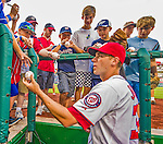26 July 2013: Washington Nationals rookie pitcher Taylor Jordan signs autographs prior to a game against the New York Mets at Nationals Park in Washington, DC. The Nationals bounced back from their loss in the first game of their day/night doubleheader, with a 2-1 nightcap win. Mandatory Credit: Ed Wolfstein Photo *** RAW (NEF) Image File Available ***