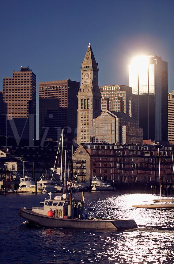 Boston city skyline view and sailboats moored in Boston Harbor, Boston, MA