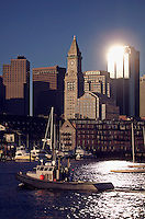 Boston city skyline view and sailboats moored in Boston Harbor, Boston, MA