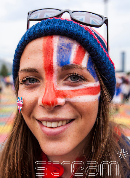 Young smiling woman with Union Jack facepaint and sunglasses at the Olympic Park during the London 2012 Olympics