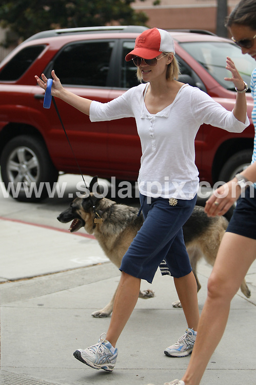 **ALL ROUND PICTURES FROM SOLARPIX.COM**.**WORLDWIDE SYNDICATION RIGHTS EXCEPT FOR USA, AUSTRALIA & GERMANY**.Reese Witherspoon takes Jake Gyllenhall's dog for a walk in Santa Monica and Brentwood, California, USA. 23rd August 2008 ..JOB REF: 7100 LAS       DATE: 23_08_2008.**MUST CREDIT SOLARPIX.COM OR DOUBLE FEE WILL BE CHARGED* *UNDER NO CIRCUMSTANCES IS THIS IMAGE TO BE REPRODUCED FOR ANY ONLINE EDITION WITHOUT PRIOR PERMISSION*