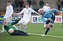 Ayr Utd Goalkeeper Graeme Smith stops Forfar's Ross Campbell at close range.