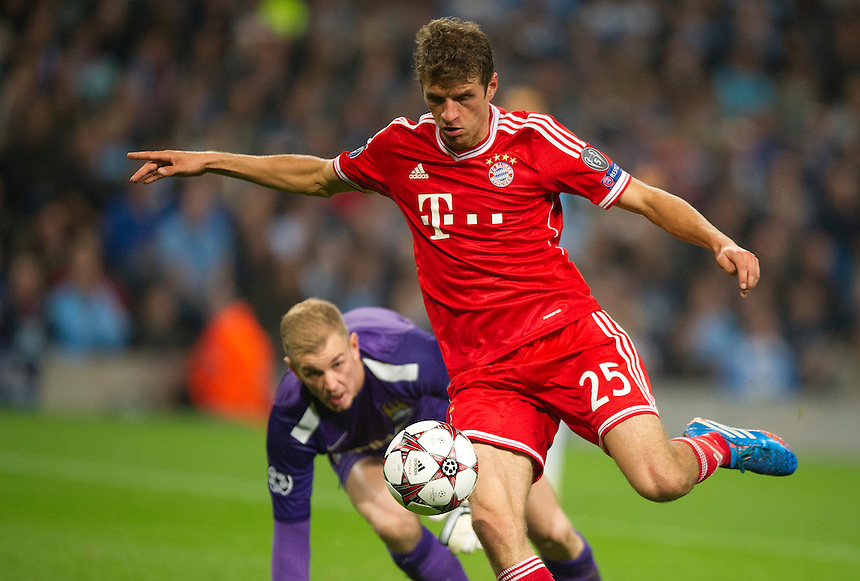 Bayern Munich's Thomas Muller controls the ball past Manchester City's Joe Hart and scores his sides second goal <br /> <br /> Photo by Stephen White/CameraSport<br /> <br /> Football - UEFA Champions League Group D - Manchester City v Bayern Munich - Wednesday 2nd October 2013 -  Etihad Stadium - Manchester<br /> <br /> &copy; CameraSport - 43 Linden Ave. Countesthorpe. Leicester. England. LE8 5PG - Tel: +44 (0) 116 277 4147 - admin@camerasport.com - www.camerasport.com