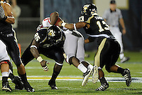 11 September 2010:  FIU cornerback Jonathan Cyprien (25) and linebacker Toronto Smith (13) combine to stop Rutgers wide receiver Mohamed Sanu (6) in the second quarter as the Rutgers Scarlet Knights defeated the FIU Golden Panthers, 19-14, at FIU Stadium in Miami, Florida.