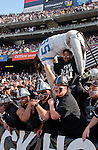 """Raider fans in the """"Black Hole"""" use dummy with number 55 on it to intimidate San Diego Chargers linebacker Junior Seau (55) on Sunday, November 18, 2001, in Oakland, California. The Raiders defeated the Chargers 34-24."""