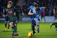 Scott Kashket of Wycombe Wanderers pressures Oscar Threlkeld of Plymouth Argyle during the Sky Bet League 2 match between Plymouth Argyle and Wycombe Wanderers at Home Park, Plymouth, England on 26 December 2016. Photo by Mark  Hawkins / PRiME Media Images.