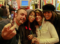Photographer Terry Mendoza takes a photograph of himself with Hope Hernandez (11), Katie Magers (11) and Patrica Libby using Hernadez's cell phone camera  at the Primitative Kool Gallery on Newport Avenue, Saturday January 26, 2008.  Mendoza had an exhibition of his photographs at the gallery.