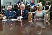 United States President Donald J. Trump congratulates NASA astronauts Jessica Meir and Christina Koch from the White House in Washington, DC after they conducted the first all-female spacewalk outside of the International Space Station on Friday, October 18, 2019.  With Trump is United States Vice President Mike Pence. left, and First Daughter and Advisor to the President Ivanka Trump, right.<br /> Credit: Chris Kleponis / Pool via CNP