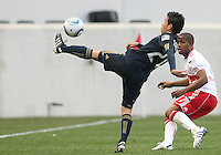 Roger Torres #20 of the Philadelphia Union boots the ball past Jeremy Hall #17 of the New York RedBulls during a MLS  match on April 24 2010, at RedBull Arena, in Harrison, New Jersey.
