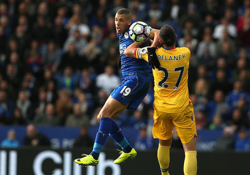 Leicester City's Islam Slimani and Crystal Palace's Damien Delaney<br /> <br /> Photographer Stephen White/CameraSport<br /> <br /> The Premier League - Leicester City v Crystal Palace - Saturday 22nd October 2016 - King Power Stadium - Leicester<br /> <br /> World Copyright &copy; 2016 CameraSport. All rights reserved. 43 Linden Ave. Countesthorpe. Leicester. England. LE8 5PG - Tel: +44 (0) 116 277 4147 - admin@camerasport.com - www.camerasport.com