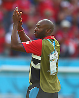 Costa Rica assistant manager Paulo Wanchope celebrates at full time