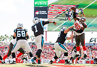 TAMPA, FL - OCTOBER 29: Defensive Tackle Chris Baker #90 of the Tampa Bay Buccaneers knocks down a Cam Newton pass during the game against the Carolina Panthers at Raymond James Stadium on October 29, 2017, in Tampa, Florida. The Buccaneers lost 17-3. (photo by Matt May/Tampa Bay Buccaneers)