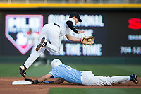 Jonah Bride (20) of the South Carolina Gamecocks attempts to tag out Cody Roberts (11) of the North Carolina Tar Heels at second base at BB&T BallPark on April 3, 2018 in Charlotte, North Carolina. The Tar Heels defeated the Gamecocks 11-3. (Brian Westerholt/Four Seam Images)