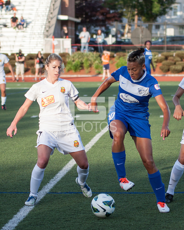 In a National Women's Soccer League Elite (NWSL) match, the Boston Breakers defeated the Western New York Flash  2-1, at Dilboy Stadium on May 5, 2013.  Western New York Flash midfielder McCall Zerboni (7) and Boston Breakers forward Lianne Sanderson (10) compete for the ball near the Flash's goal.