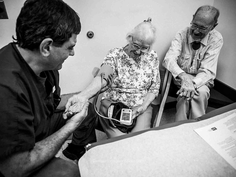 PA Arthur Cerami consults with Charlotte Lambert, 91, and her husband,  Hoy Lambert, 83,  at the E.A. Hawse medical center in Mathias, West Virginia.