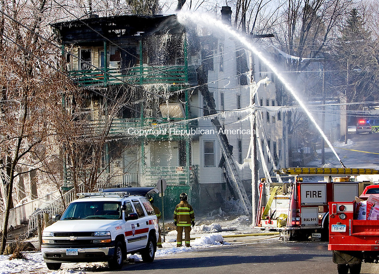 WATERBURY, CT. 22 January 2008-012208SV01--Firefighters use a deck gun to shoot water onto a six family house on Pearl Street that was devastated by an early morning fire in Waterbury Tuesday.<br /> Steven Valenti Republican-American