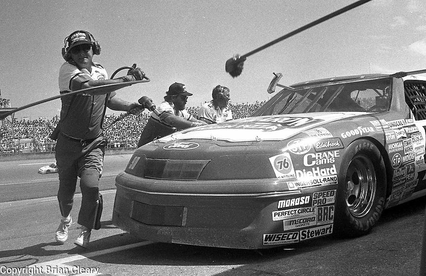 Ken Schrader #90 Ford Thuderbird pits pit stop Pepsi Firecracker 400 Daytona International Speedway Daytona Beach FL July 1987 (Photo by Brian Cleary/www.bcpix.com)