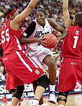 FRESNO, CA. 24 March 2007-032407SV01--#31 Tina Charles of UConn looks to the hoop as #55 Gillian and #1 Kahadijah Whittington of NC State defend during the sweet sixteen round of the NCAA tournament at the Save Mart Center in Fresno, CA. Saturday.<br /> Steven Valenti Republican-American