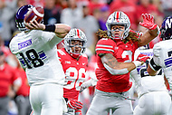 Indianapolis, IN - DEC 1, 2018: Northwestern Wildcats quarterback Clayton Thorson (18) gets the ball off before Ohio State Buckeyes defensive end Chase Young (2) can make the sack during first half action of the Big Ten Championship game between Northwestern and Ohio State at Lucas Oil Stadium in Indianapolis, IN. (Photo by Phillip Peters/Media Images International)