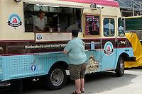 Overweight man ordering ice cream from a food truck in downtown Vancouver, BC, Canada