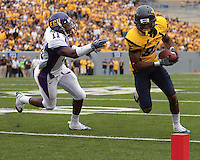 WVU wide receiver Alric Arnett scores. The WVU Mountaineers defeated the East Carolina Pirates 35-20 at Mountaineer Field at Milan Puskar Stadium, Morgantown, West Virginia on September 12, 2009.