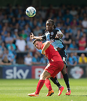Reece Thompson of York City and Marcus Bean of Wycombe Wanderers battle for the ball during the Sky Bet League 2 match between Wycombe Wanderers and York City at Adams Park, High Wycombe, England on 8 August 2015. Photo by Andy Rowland.
