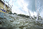 Water swirls around a camera dipped off of the side of South River Riverkeeper Diana Mueller's boat in a creek off of the South River.