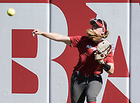 NWA Democrat-Gazette/CHARLIE KAIJO An Arkansas Razorbacks outfielder throws the ball during a softball match, Sunday, October 28, 2018 at Bogle Park, University of Arkansas in Fayetteville.<br />
