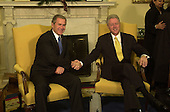 United States President-elect George W. Bush, left, shakes hands with U.S. President Bill Clinton, right, in the Oval Office of the White House in Washington, DC on December 19, 2000.<br /> Credit: Ron Sachs / Pool via CNP