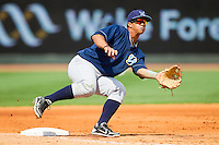 Cheslor Cuthbert (32) of the Wilmington Blue Rocks waits for a throw at third base during the game against the Winston-Salem Dash at BB&T Ballpark on April 21, 2013 in Winston-Salem, North Carolina.  The Blue Rocks defeated the Dash 5-3.  (Brian Westerholt/Four Seam Images)
