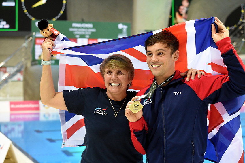 Great Britain's Tom Daley with his coach Jane Figueiredo after winning Gold during  the mixed 3m Synchro Springboard and bronze in the men's 10m platform<br /> <br /> Photographer Hannah Fountain/CameraSport<br /> <br /> FINA/CNSG Diving World Series 2019 - Day 3 - Sunday 19th May 2019 - London Aquatics Centre - Queen Elizabeth Olympic Park - London<br /> <br /> World Copyright © 2019 CameraSport. All rights reserved. 43 Linden Ave. Countesthorpe. Leicester. England. LE8 5PG - Tel: +44 (0) 116 277 4147 - admin@camerasport.com - www.camerasport.com