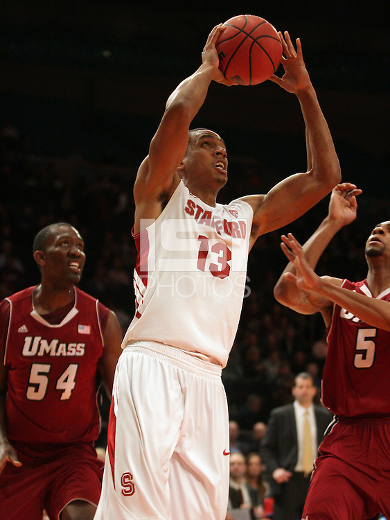 Stanford's Josh Owens (13) takes a shot as UMass' Jesse Morgan (5) defends during the first half in a semifinal game of the NIT at Madison Square Garden, New York, N.Y., Tuesday, March 27, 2012.