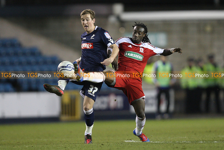 Harry Kane of Millwall and Marvin Emnes of Middlesborough - Millwall vs Middlesborough - nPower Championship Football at The New Den, London - 21/02/12 - MANDATORY CREDIT: Gavin Ellis/TGSPHOTO - Self billing applies where appropriate - 0845 094 6026 - contact@tgsphoto.co.uk - NO UNPAID USE.