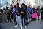 Protesters calling on Chicago Mayor Rahm Emanuel to resign hold hands and block traffic on Michigan Avenue at Wacker Drive in the Loop in Chicago, Illinois on December 9, 2015.  Emanuel offered a historic apology for the police killing of Laquan McDonald and police brutality and racial profiling generally -- without using those words -- in front of the City Council in the morning.