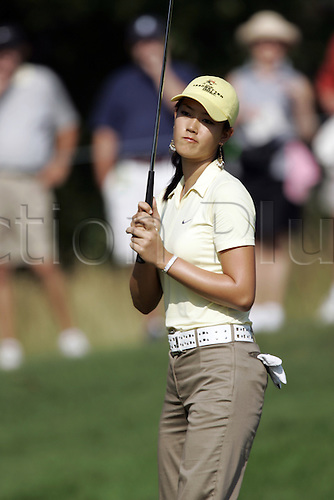 7 July 2005: Michelle Wie shows her disappointment after missing a putt on the first hole in the first round of the John Deere Classic at the TPC at Deere Run in Silvis , Il. The 15-year-old shot a 1-under 70 giving herself a good chance of becoming the first woman in 60 years to make a cut on the PGA Tour. Photo: Mark Cowan/actionplus...women woman lady girl 050707 loser losing golf golfer