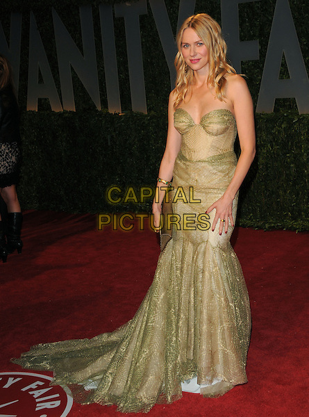 NAOMI WATTS .at The 2009 Vanity Fair Oscar Party held at The Sunset Tower Hotel in West Hollywood, California, USA, .February 22nd 2009                                                                                      .oscars after full length Strapless green gold lace dress long maxi gown bustier .CAP/DVS.©Debbie VanStory/Capital Pictures
