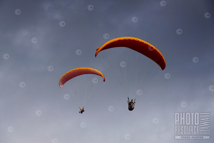 Two men paragliding over O'ahu.