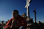 pvc042211c/4-22-11/asec.  At first light, Carlos Morales (CQ) of Los Lunas, prays near the base of three crosses at the top of Tome Hill on Good Friday, photographed Friday April 22, 2011.  Morales said he has made the pilgrimage to Tome for 14 years, and this year was thanking God for not letting his wife Sandra Dominguez die following a serious medical situation she had.  (Pat Vasquez-Cunningham/Journal)