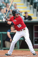 Jake Elmore (10) of the Oklahoma City RedHawks at bat during the Pacific Coast League game against the Round Rock Express at Chickashaw Bricktown Ballpark on June 14, 2013 in Oklahoma City ,Oklahoma.  (William Purnell/Four Seam Images)